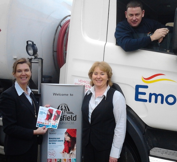 Emo driver Noel Leahy helps Geraldine Kearney and Michelle McCarthy launch the new Home Heat Assist, a new home heating oil offer for members of Sarsfield & Monaleen Credit Unions in Limerick