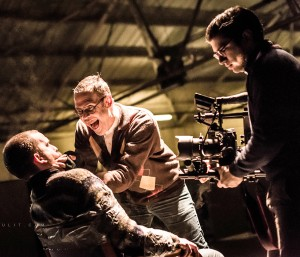 On the set of Limerick band's Fox Jaw new video - Richard playing a maniacal serial killer who tortures actor Kevin Kiely as director Shane Serrano captures the action. Picture: Tarmo Tulit