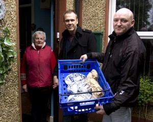 Richard pictured with Marie O Donovan as she has her Meals on Wheeels delivered to her door by Ger O Halloran from St. Munchins Community Centre. Picture: Leon Ledger