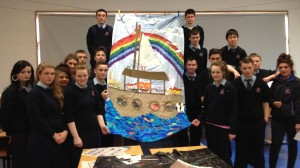 Noye's Fludde designer Emma Fisher has led workshops in four city schools, working on masks, costumes and design. Pictured with students with their poster