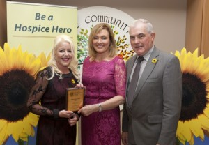 Anne Coughlan is presented with A Hospice Sunflower Hero Award in Dublin by RTE's Mary Kennedy.