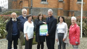 Pictured: Father Tom Mangan being presented with the Award by Maura O'Neill of Limerick Tidy Towns outside St Joseph's, along with members of the South Limerick Residents Association.