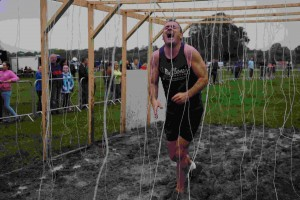 """Cliona's Foundation Brendan Ring """"endures"""" the Electric Eels obstacle at Adare to Survive 2013. Photo by Ian Tully."""