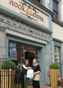 Pictured: Manager of Hook & Ladder, Aisling Meehan, being presented with the Award by Maura O'Neill of Limerick Tidy Towns outside the café.