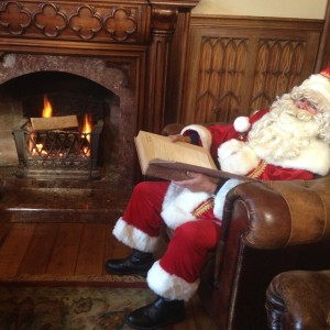 Bringing the magic to the castle library, Santa enjoying the cosy fire
