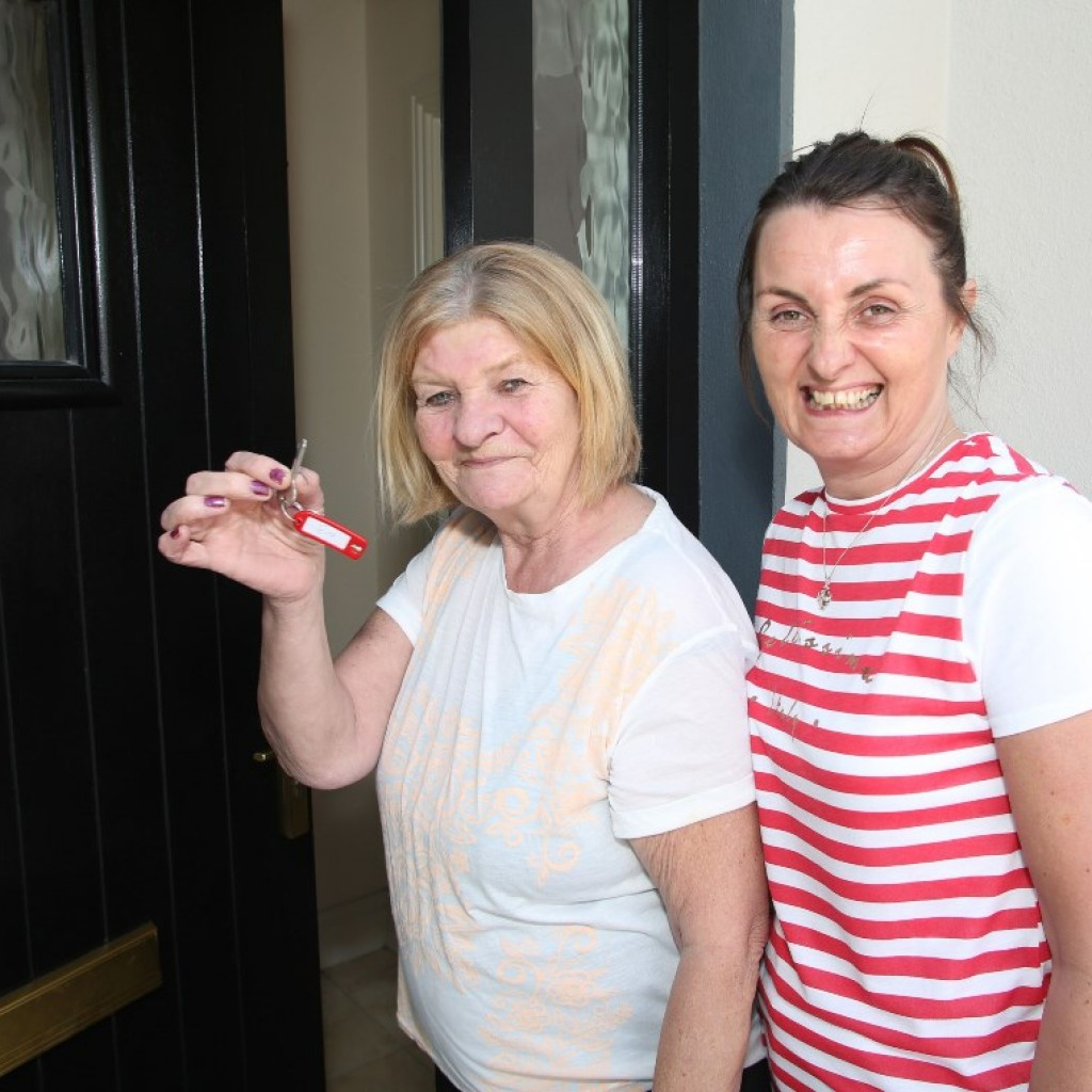 With Compliments.   Families have begun moving into Limerick City and County Council's new housing development at Waller's Wall on Roxboro Road.  Waller's Well is a development of 10 three bedroom homes which have been delivered by the Council in the Janesboro/Rathbane area under the Regeneration programme.  Pictured are delighted Mary Fitzgerald about to enter her new home in  Wallers Well accompanied by her daughter Tanya.    Photograph Liam Burke/Press 22