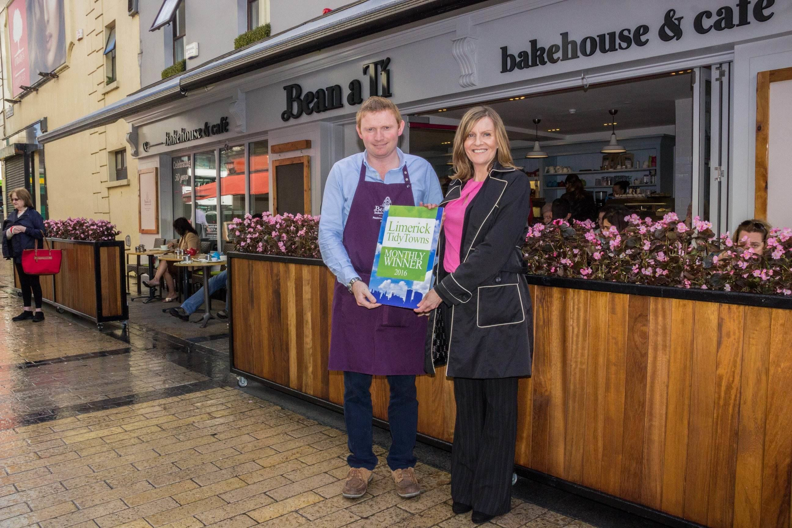 Bean Ati Celebrates Fifty Business Years. John Canty of Bean a Ti Bakery receiving the Limerick Tidy Towns Monthly Award September 2016 with Maura O'Neill of Limerick Tidy Towns. Picture Cian Reinhardt/ilovelimerick.