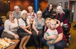 Pictured front row, second from left, Dorothy Meaney, Mid West Carer of the year 2016 winner, with her family at the Family Carers Ireland Award 2016 in the Absolute Hotel. Picture: Cian Reinhardt/ilovelimerick