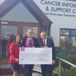 Meg Wiley Curran pictured presenting her check to LisaTracey and Professor Gupta of the Mid Western Cancer Foundation