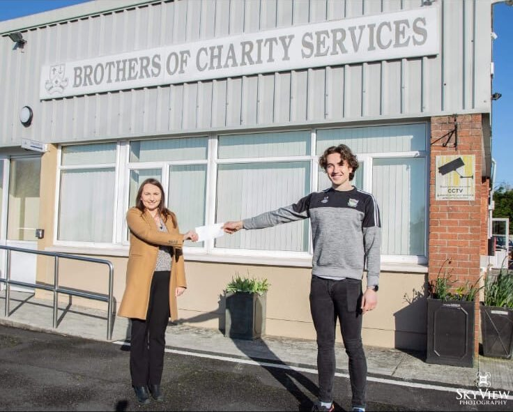 Newcastle West GAA club member Cian Sheahan pictured above with a representative from the Brothers of Charity