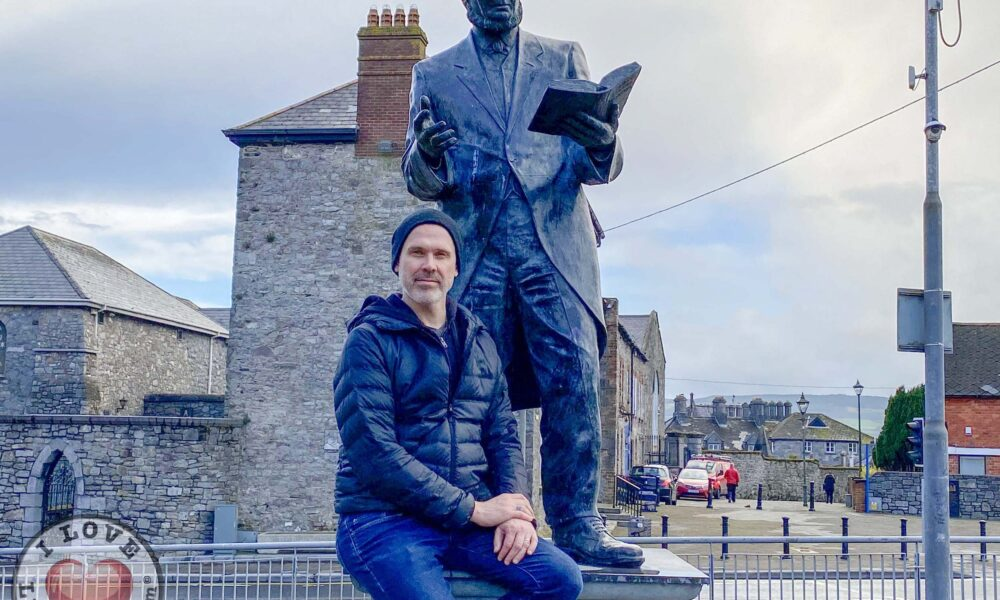 Bard of Thomond - Richard Lynch, I Love Limerick pictured with the Michael Hogan, Bard of Thomond statue outside King John's Castle. Picture: ilovelimerick