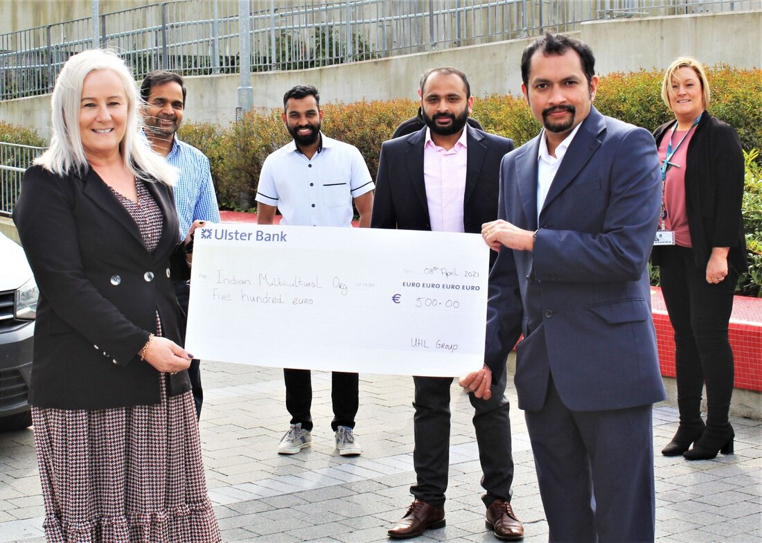 Colette Cowan, CEO, UL Hospitals Group, presents a cheque to Jose Lukose, Munster Indian Cultural Association (MICA). Also pictured are (centre, from left) Babu Baskaran, Nishad Badarudeen, and Lino Varghese (MICA); and (back, from left) Niall Joyce, UL Hospitals Group (partially obscured); and Linda Fahy, UL Hospitals Group.