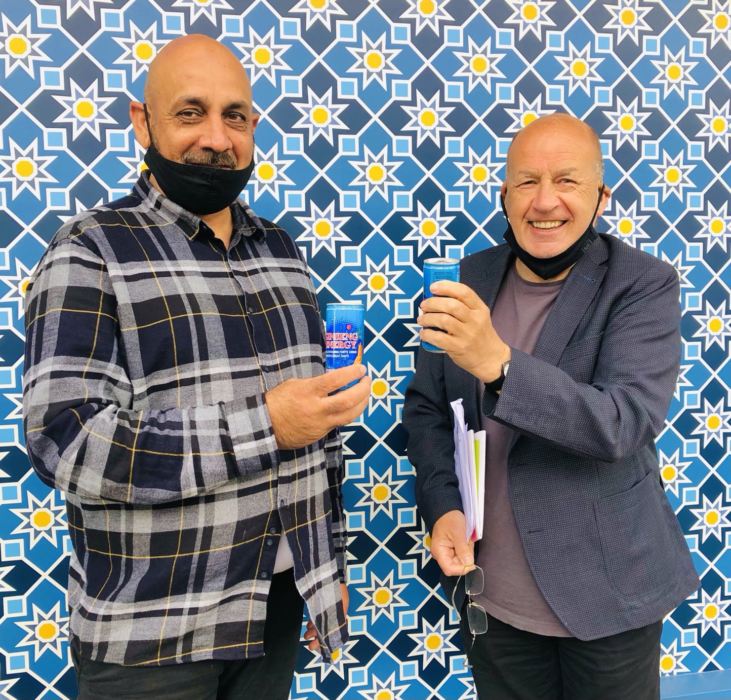 Raqibullah Hamadi and John Logan enjoying a complimentary ginger root drink. Picture: Deirdre Power