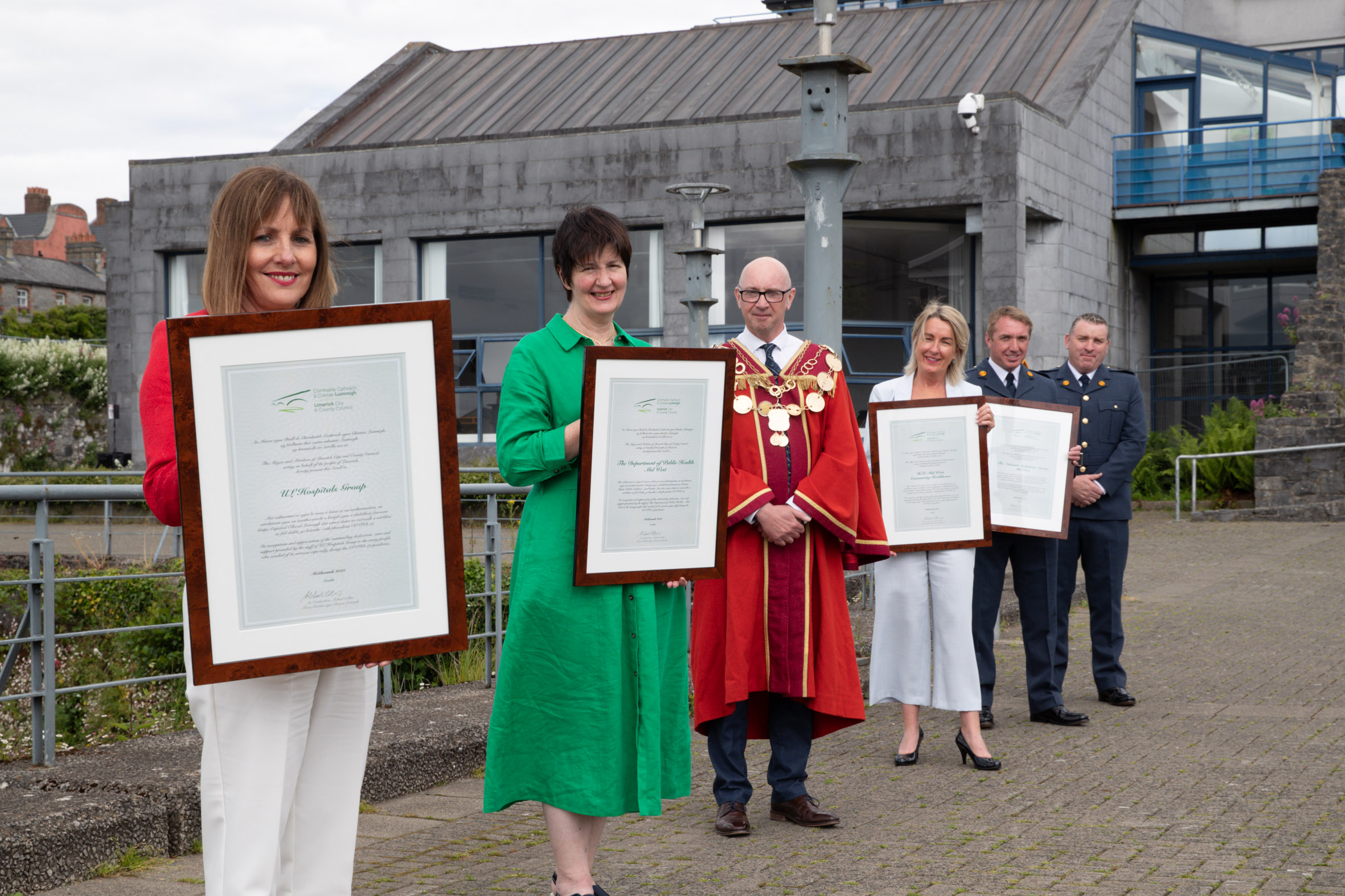 Mayor Michael Collins presented scrolls to representatives of the UL Hospitals Group, National Ambulance Service  Midwest, Department of Public Health Midwest and HSE Midwest Community Healthcare. Picture: Keith Wiseman