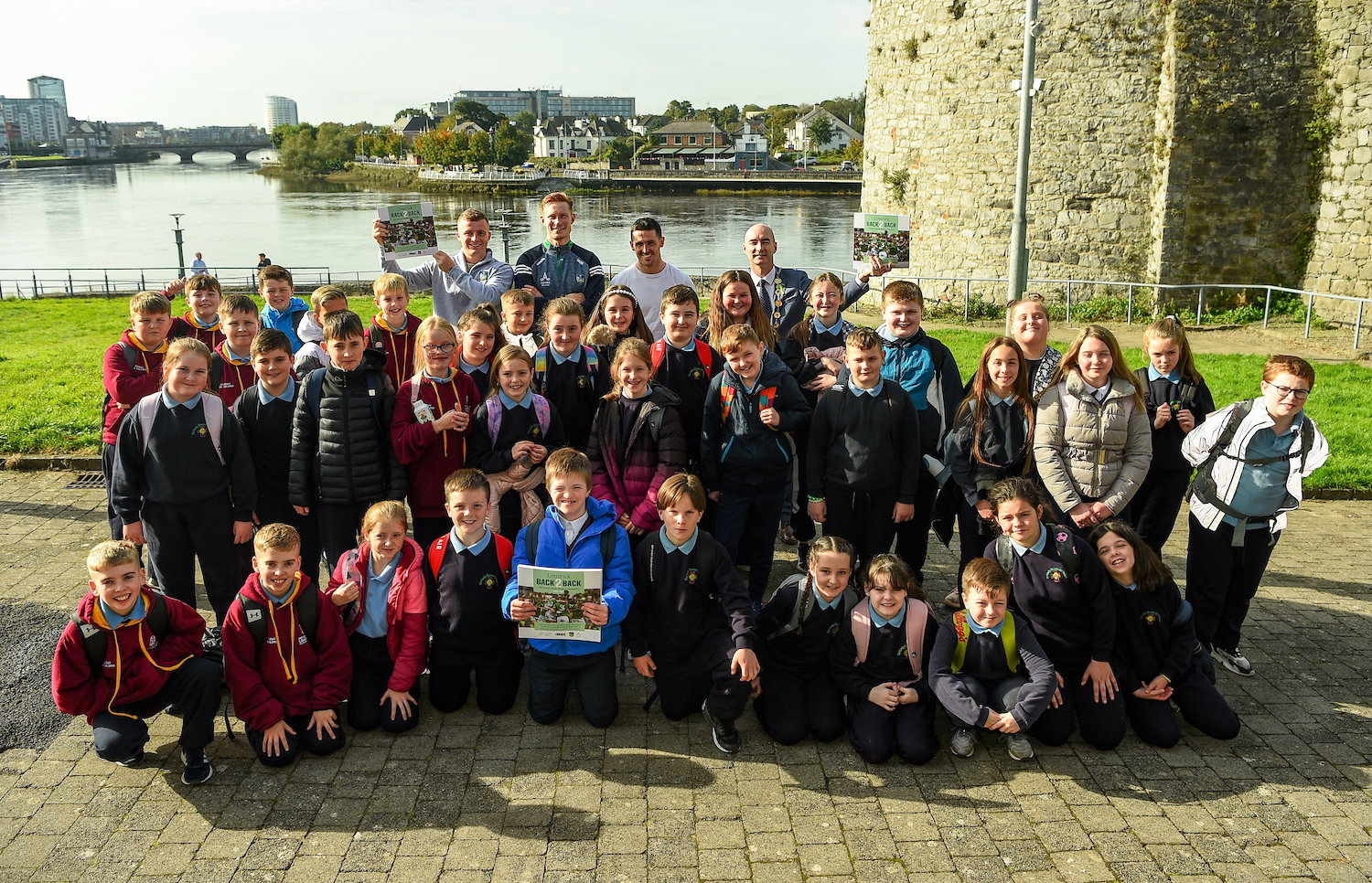 Limerick Back 2 Back book - 5th class students from Our Lady Queen of Peace Primary School along with Limerick hurlers, back row, from left, Peter Casey, William O'Donoghue and Darragh O'Donovan with Cllr Daniel Butler, Mayor of the City and County of Limerick at the launch of 'Back 2 Back' at Limerick City and County Council offices at Merchants Quay in Limerick. Picture: Diarmuid Greene/Sportsfile