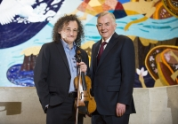 "27/01/2016The University of Limerick names Clare fiddler Martin Hayes as its inaugural Irish World Academy Artist.Pictured at the announcement are Professor Don Barry, University of Limerick President, right, and Irish World Academy Artist Martin Hayes.The University of Limerick has announced a new three-year arts patronage award through the Irish World Academy of Music and Dance. The award, entitled Irish World Academy Artist, University of Limerick will facilitate the creative process of selected artists across a three-year period through a budget of €60,000.The first artist to receive the award is Clare fiddler Martin Hayes who commences his three-year association with the Irish World Academy, University of Limerick in January 2016. Martin Hayes has been internationally acclaimed for bringing his local East Clare traditional fiddle style to a global audience through his many performances and recording. More recently he has formed the ensemble The Gloaming which has further pushed the boundaries of Irish traditional music in the field of ensemble playing that started with Sean Ó Riada's (1930 – 1971) pioneering ensemble Ceóltóirí Chualainn in the 1960s. Hayes also acknowledges the significant influence of Dublin fiddler Tommie Potts (1912 – 1987) on his creative output.The Irish World Academy Artist at the University of Limerick will undertake a series of creative projects across the three-year span. Students of the Academy will have access to open workshops in the state-of-the-art Irish World Academy building on the banks of the river Shannon on the University Campus.(Speaking at the launch of the award) Professor Don Barry, President of the University said: ""It is fitting that an artist of the stature of Martin Hayes should be the inaugural Irish World Academy Artist, given Martin's unique contribution to our cultural life and the Irish World Academy's vision for Ireland's past, present and future.""On his appointment, Martin Hayes said: ""I'm deeply honoured to be named the first Irish World Academy Artist at the University of Limerick and grateful for the opportunity this three year initiative affords me to explore the possibility of further musical collaboration in such a creative environment."" Professor Mícheál Ó Súílleabháin, Chair of Music and Founder Director of the Irish World Academy said: ""The Irish World Academy Artist initiative is further evidence of the commitment of the University of Limerick to the Performing Arts at the highest level. That the first award goes to a local artist with a global reputation builds on the Irish World Academy record of linking the local with the global towards the mutual benefit of both.""Picture credit: Diarmuid Greene/Fusionshooters"
