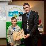22.11.2016 Christmas has come early for two Limerick students after they were named overall winners of the 2016 Limerick City Fairtrade Christmas Card Competition at a ceremony in The Savoy Hotel. Receiving their prize from Deputy Mayor Cllr. Frankie Daly was Paul Reddan, Corpus Christi Primary School, Moyross. Picture: Alan Place