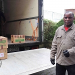 Patrick Lananga, volunteer, helping to load the second-hand books to Malawi at the Gateway to Education warehouse. Picture: Conor Owens/ilovelimerick.