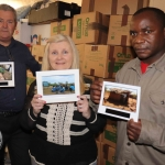 Ian Mills, shop manager, Suzanne Roche, CEO and founder, and Patrick Lananga, volunteer, at the Gateway to Education's delivery of second-hand books to Malawi Event. Picture: Conor Owens/ilovelimerick.