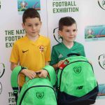 Pictured at the UL Sports Arena for the donation of 50 FAI Backpacks to Limerick's Gateway to Education by the National Football Exhibition are the winners of the Gateway to Education social media competition Daniel Wilkinson, age 10 and Nathan McKevitt, age 7. Picture: Conor Owens/ilovelimerick.