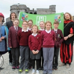 Sinestro the Jester, Mikey Casey and Jared Nadin with Martins Town primary school students at the Pay It Forward Limerick event at King Johns Castle on May 15 2018. Picture: Zoe Conway/ilovelimerick.
