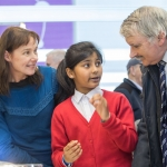 20/01/17 REPRO FREE Pictured at the 2017 RDS Primary Science Fair Limerick was Mary O'Leary and Realta Haque from Naas Community School, Kildare explaining their project, Can we create rainbows without rain to Willie O'Dea.. This year the Limerick Fair doubled capacity to 120 schools, in only its second year. In total, across three venues: Dublin, Limerick and Belfast, a total of 7,500 primary school students will participate at the Fair. This is the first year of the RDS Primary Science Fair Belfast. Photo: Sean Curtin True Media.