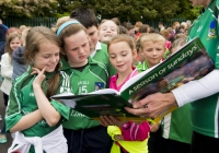 "04/06/2015 St Brigid's NS were awarded their 5th Green Flag and Limerick manager TJ Ryan and Limerick hurler Kevin Downes were on hand to help the students raise the flag. Looking at a picture of Limerick manager TJ Ryan in Sportsfile's ""A Season of Sundays"" are 3rd class students Katie Clohessy, Libby Costelloe, Jodie Griffin, and Ben Moloney. St Brigid's NS, Singland, Limerick. Picture credit: Diarmuid Greene"