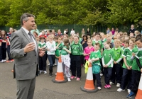 04/06/2015 St Brigid's NS were awarded their 5th Green Flag and Limerick manager TJ Ryan and Limerick hurler Kevin Downes were on hand to help the students raise the flag. Pictured is Limerick senior hurling manager TJ Ryan addressing the students before the raising of their fifth green flag. St Brigid's NS, Singland, Limerick. Picture credit: Diarmuid Greene