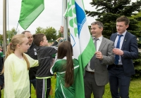 04/06/2015 St Brigid's NS were awarded their 5th Green Flag and pictured at the official raising of the flag (for Bio Diversity) are, from left to right, students Ally Davis, 6th class, Darragh Whelan, 1st class and Emma Normoyle, 4th class, along with Limerick hurling manager TJ Ryan and Limerick hurler Kevin Downes. St Brigid's NS, Singland, Limerick. Picture credit: Diarmuid Greene