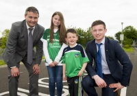 04/06/2015 St Brigid's NS were awarded their 5th Green Flag and pictured at the official raising of the flag (for Bio Diversity) are, students Emma Normoyle, 4th class, and Darragh Whelan, 1st class, along with Limerick hurling manager TJ Ryan and Limerick hurler Kevin Downes. St Brigid's NS, Singland, Limerick. Picture credit: Diarmuid Greene