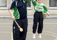 04/06/2015 St Brigid's NS were awarded their 5th Green Flag and Limerick manager TJ Ryan and Limerick hurler Kevin Downes were on hand to help the students raise the flag. Pictured during a hurling training session is Emily O'Callaghan-Smith, 1st class, along with hurling coach Mike Power, Claughaun GAA club. St Brigid's NS, Singland, Limerick. Picture credit: Diarmuid Greene