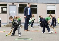04/06/2015 St Brigid's NS were awarded their 5th Green Flag and Limerick manager TJ Ryan and Limerick hurler Kevin Downes were on hand to help the students raise the flag. Pictured during a hurling training session is Darragh Whelan, 1st class, left and Sarah O'Sullivan, 1st class, watched closely by Limerick hurler Kevin Downes. St Brigid's NS, Singland, Limerick. Picture credit: Diarmuid Greene