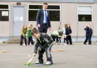 04/06/2015 St Brigid's NS were awarded their 5th Green Flag and Limerick manager TJ Ryan and Limerick hurler Kevin Downes were on hand to help the students raise the flag. Pictured during a hurling training session is Darragh Whelan, 1st class, watched closely by Limerick hurler Kevin Downes. St Brigid's NS, Singland, Limerick. Picture credit: Diarmuid Greene