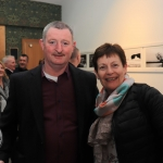 Pictured at the St Munchin's Photography Club's 'Moments in Time' Exhibition in the Belltable Arts Hub are Tony Ryan, Chairperson of the Photography club, and Teresa Gardner. Picture: Conor Owens/ilovelimerick.