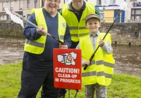 03.04.15  NO REPRO FEE Paul O'Connell, AP McCoy and JP McManus kick-start the Team Limerick Clean-Up (TLC). Over 10,000 volunteers hit the streets of Limerick City and County for the country's biggest ever Clean-Up. Limerick senior hurler Donal O'Grady joined Team Limerick Clean-Up volunteers, Kieran Byrnes, left, and Alex Massey, aged 7, from Newcastlewest, Co. Limerick. Picture credit: Diarmuid Greene/Fusionshooters